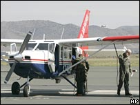 Members of the Nevada Air National and Civil Air Patrol are seen near a specially equipped aircraft to be used in the search for famed aviator Steve Fossett, at the airport in Minden, Nevada