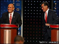 Rudy Giuliani (L) and Mitt Romney during the Republican debate in New Hampshire