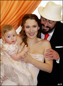 Luciano Pavarotti with his wife Nicoletta and daughter Alice on their wedding day