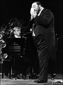 Italian opera tenor Luciano Pavarotti wipes his face during a performance at Bussoladomani, on the Versilia coast of Italy in 1985.