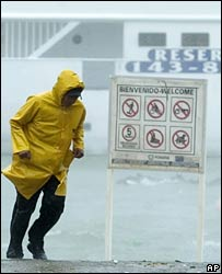 A man fights the wind during hurricane Henriette at Cabo San Lucas, 04/09