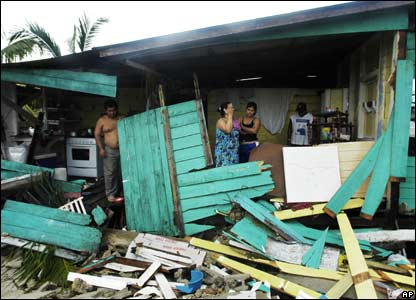 Residents of Puerto Cabezas, Nicaragua amid the remnants of their home