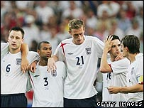 The England team brace themselves for penalties defeat against Portugal