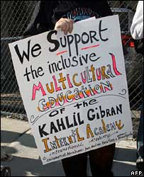 A supporter of the Khalil Gibran International Academy holds up a sign