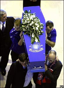 Rhys Jones' coffin is carried into church