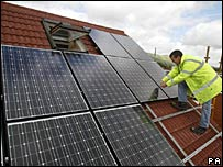 Solar panels being fitted on a roof