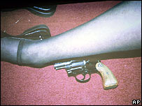 Photograph of Lana Clarkson's legs with gun