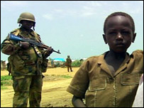 African Union peacekeeper and child in Al Salaam