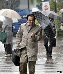 A man holds an umbrella in Tokyo on 7 September 2007