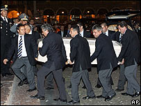 Pavarotti's coffin is carried into the cathedral