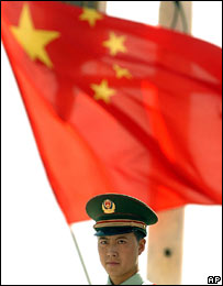 File image of a policeman standing in front of the Chinese flag