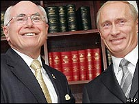 John Howard (left) and Vladimir Putin