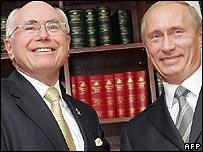 John Howard (left) and Vladimir Putin