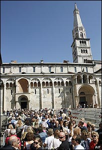 Mourners queue outside Modena cathedral