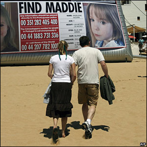 Kate and Gerry McCann with appeal poster
