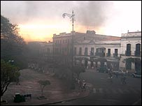 Smoke surrounds buildings in Sucre