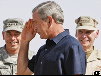 President Bush, centre, at Al-Asad Airbase, Iraq, with Gen David Petraeus (left) and commander William Fallon