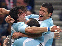 Argentina celebrate Ignacio Corleto's first-half try in the opening game against France