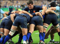 France's Fabien Pelous (C) holds fast in a maul during the rugby union World Cup opening match