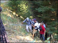 Mrs Anderson being carried out of canyon by a rescue team