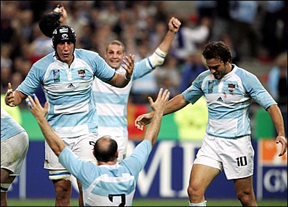 Argentina players celebrate after beating hosts France
