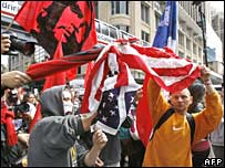 Protesters burn a US flag during a rally near the Apec summit in Sydney 8 September 2007