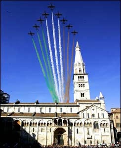 The Italian acrobatics flight team pass over Modena's Cathedral, northern Italy, after the Luciano Pavarotti funeral, Saturday