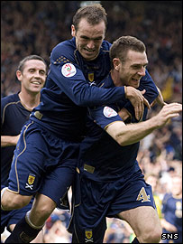 Stephen McManus celebrates his second half goal at Hampden