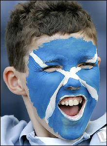 A young Scotland fan enjoys the performance
