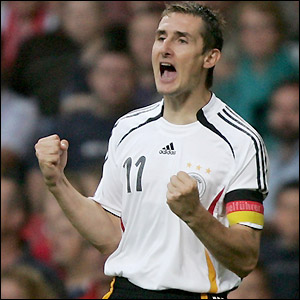 Klose celebrates his early goal for Germany