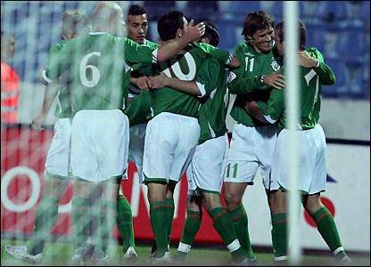 Ireland's players celebrate the opening goal