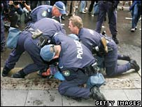Police tackle a protester (Saturday 8 September)