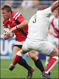 England captain Phil Vickery (right) trips USA centre Paul Emerick