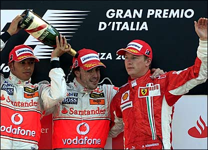 Fernando Alonso (centre) is joined by Lewis Hamilton (left) and Kimi Raikkonen on the podium