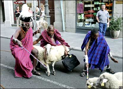 African herdsmen help guide a flock of sheep through the streets of in Madrid