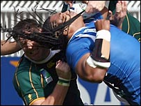 South Africa lock Bakkies Botha gets to grips with Samoa wing Alesana Tuilagi