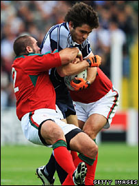 Marcus Di Rollo of Scotland is tackled by Diogo Mateus (left) and Federico Sousa (right) of Portugal