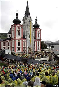 Believers listen to the Pope at the basilica in Mariazell, Austria