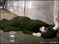 A person lying in the street following an evening out