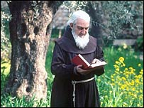 Monk reads book