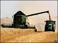 A combine harvester and tractor