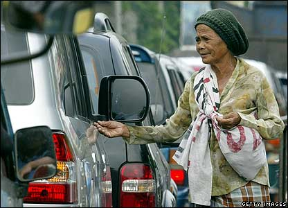 A beggar approaches cars in Jakarta, Indonesia