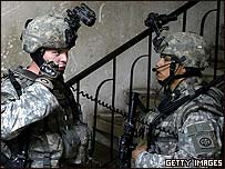Coalition troops inspect a house in Baghdad
