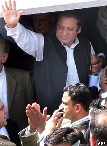 Former Pakistani Prime Minister Nawaz Sharif waves as he lands in Islamabad airport