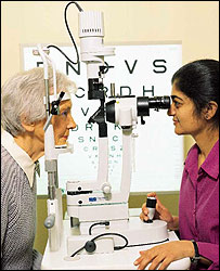 Photo of a woman having her eyes tested - photo courtesy of RNIB