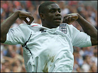Micah Richards celebrates his goal against Israel