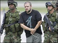 Diego Montoya (centre) in custody