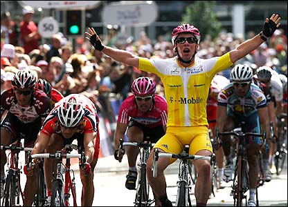 Britain's Mark Cavendish celebrates winning the opening stage of the Tour of Britain in Southampton