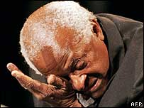 Archbishop Desmond Tutu cries while Peter Gabriel sings Biko