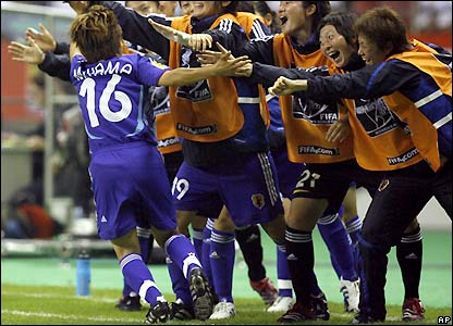 Miyama celebrates with her team-mates